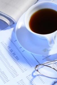 black coffee,glasses and newspaper on business file